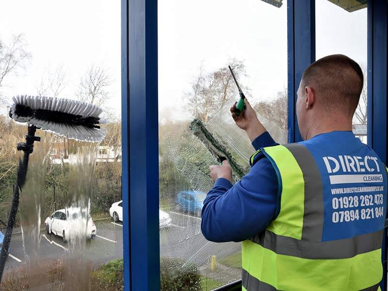 window cleaner cleaning windows