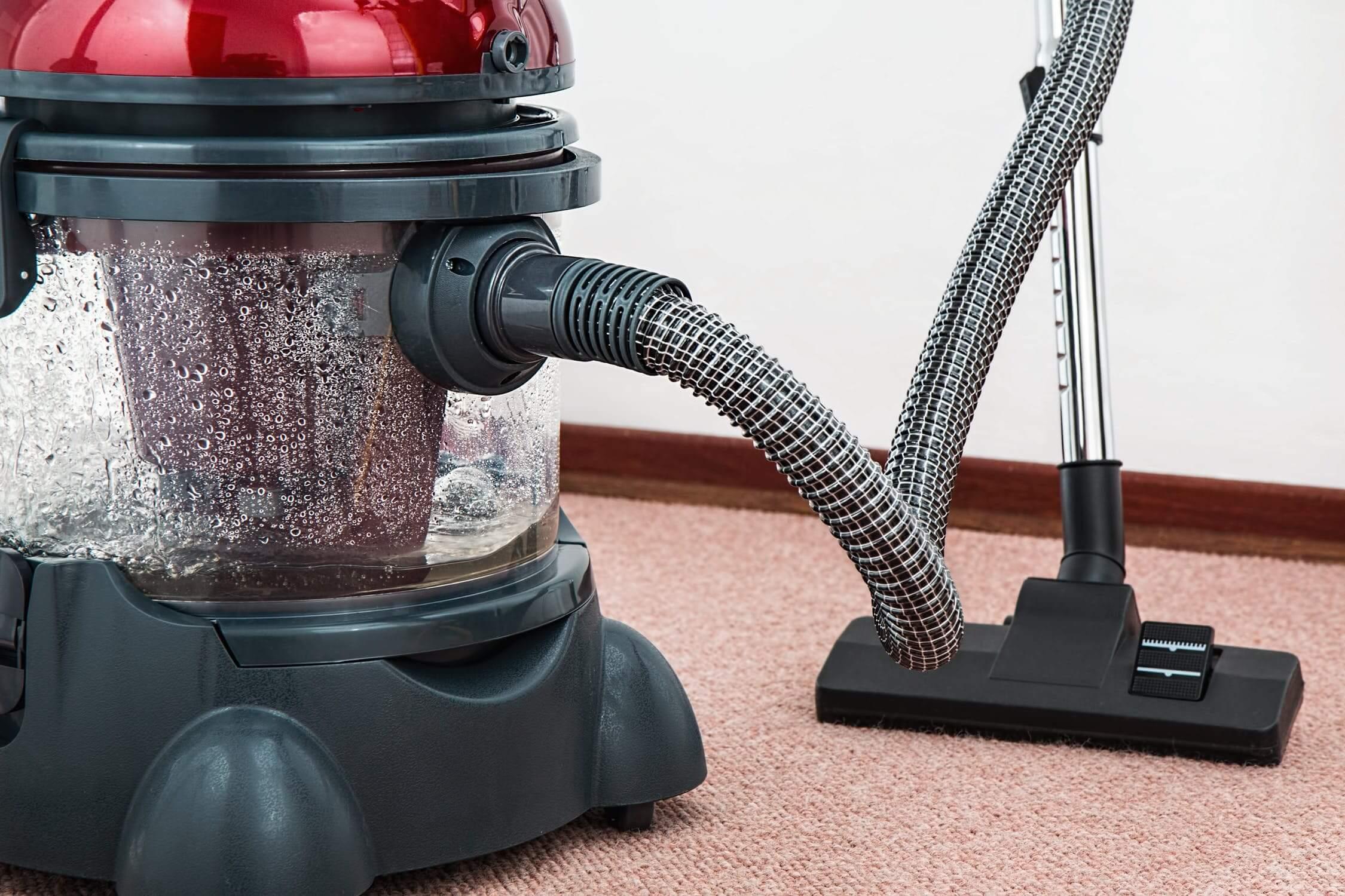 Close up of vacuum and carpet